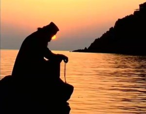 Monk Praying in Sunset
